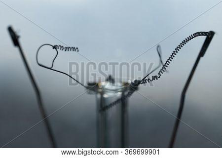 Broken Wire Filament Of A Burned Incandescent Light Bulb Macro