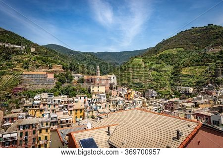 Cityscape Of The Ancient Village Of Vernazza And The Terraced Fields, Green Vineyards. Cinque Terre,
