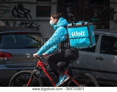 Belgrade, Serbia - May 6, 2020: Wolt Delivery Man Wearing A Face Mask Protective Respirator In Belgr