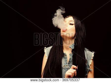 Girl Vaping. Glamorous Brunette Smoking Vaping Device Black Background. Rest And Relax. Hookah Bar.