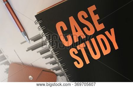 Case Studies Text Written On A Diary Cover Orange On Black. Business Concept. Selective Focus