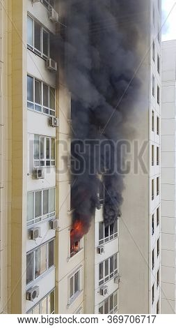 Flaming Fire With Black Smoke Form Building Windows. Accident Due Arson In Protests