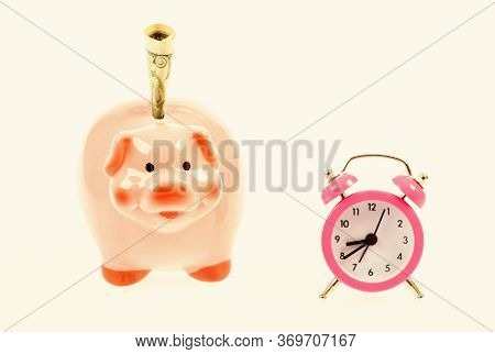 Economics And Finance. It Is Time To Pay. Piggy Bank Stuffed Dollar Cash And Alarm Clock. Financial
