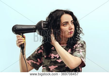 Woman Makes Herself Curly Hairstyle. Haircare Concept. Woman Drying Hair At Home. Woman Styling Her