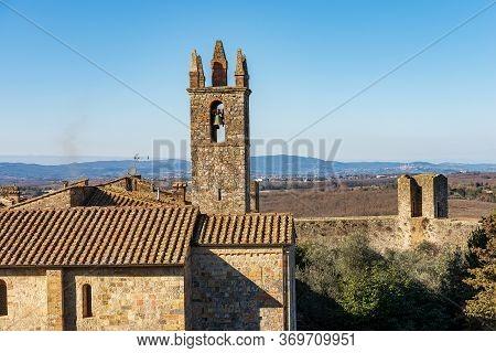 Medieval Village Of Monteriggioni. Church Of Santa Maria Assunta (xiii Century) And Surrounding Wall