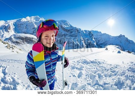 Fun Portrait From Side Of Smiling Skier Girl With Ski Standing In The Mountain Wear Pink Mask And Co
