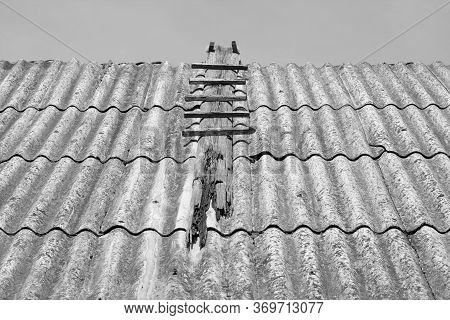 Old Wood Ladder On Top Of House Roof. Architectural Background