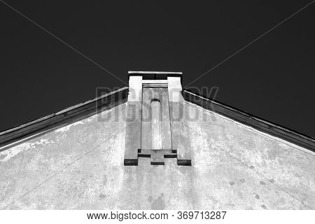 Wall And Roof Of Old House In Black And White. Urban Background