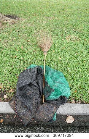 Dry Coconut Stick Broom On Grass Ground