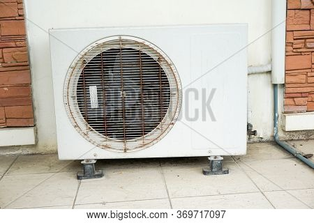 Close Up Air Conditioner On Cement Floor