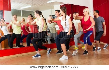 Smiling Men And Women Dancing In A Gymnastics Class On A Choreography Intensive Course