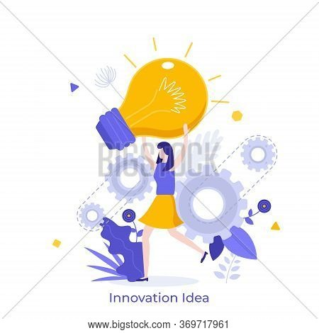 Woman Holding Giant Glowing Electric Light Bulb. Concept Of Innovative Idea, Innovation, Breakthroug