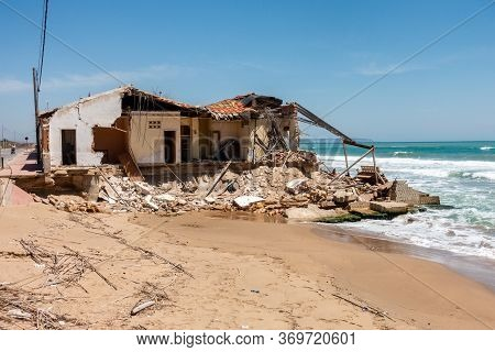 Valenciana, Spain - June 01 2020 : Storm Damaged House And Beach In Guardamar