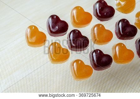 Homemade Gelatin Candies On A Beige Background. Jelly Candies With Blueberries And Orange. Treats Wi