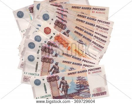 The Russian Five Thousand Ruble Note Looks Out From A Multitude Of 500-ruble Notes. Isolated