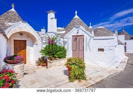 Alberobello, Italy. Idyllic Traditional Trulli Houses In Apulia Region Of Italia.