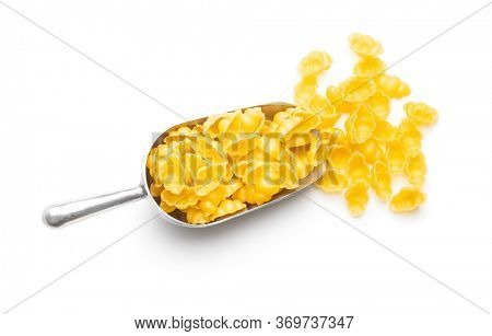 Gnocchi, raw italian pasta. Dried pasta in scoop isolated on white background.