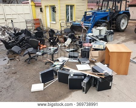 Discarded Obsolete System Units From Computers With Old Office Chairs In Trash