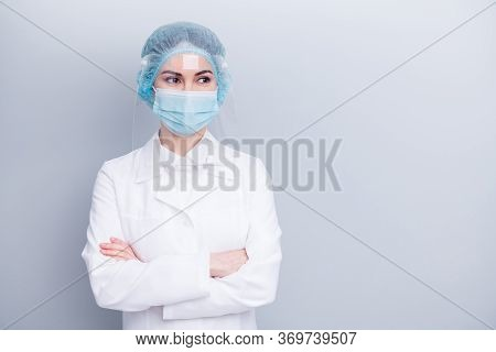 Photo Of Attractive Confident Virologist Doctor Lady Arms Crossed Good Mood Look Side Empty Space We