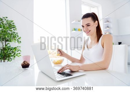 Profile Photo Of Cheerful Housewife Lady Worker Sitting Morning Kitchen Browsing Notebook Freelancer