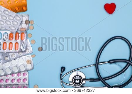 Various Medications: Pills, Blister Pills, Medicines, Medications, Statoscope And Red Copy Space On