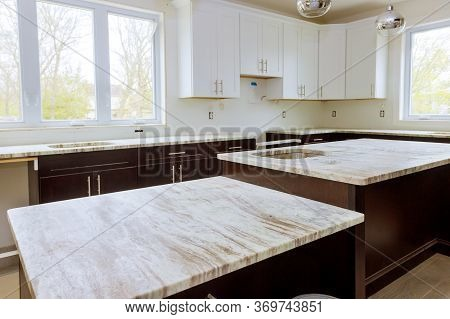 Home Improvement And Interior Design New White Kitchen Renovation Installing Cabinets And Counter To