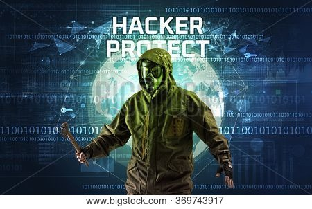 Faceless hacker at work with HACKER PROTECT inscription, Computer security concept