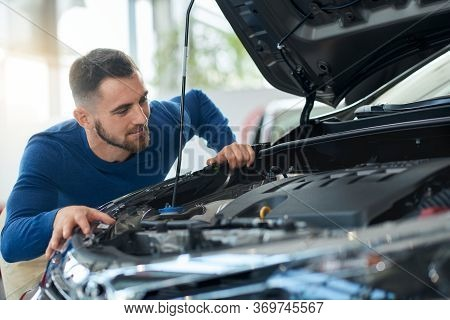 Happy Smiling Handsome Men In Shirt Looking At Opened Car Bonnet Before Successful Vehicle Buying. C