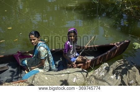 Allepey, India - March 11, 2014: A Boy With His Mother Traveling In Their Private Boat In A Most Tou