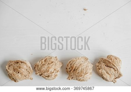 Raw Dehydrated Soy Meat Or Soya Chunks On A White Wooden Background. Top View. Copy, Empty Space For