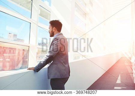 Half Length Portrait Of A Confident Businessman Conceived Looks