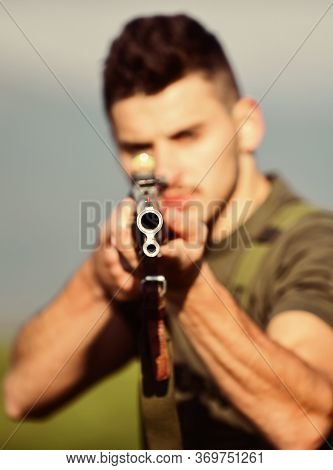 Aimed Gun Barrel. Selective Focus. Muscular Man Hold Weapon. Purpose And Success. Polygon Combat Exe