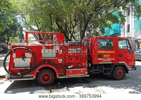 Manila, Philippines - September 24, 2018: Red Fire Truck Stands On Philippine Street In Sunny Day