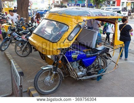 Palawan, Philippines - September 26, 2018: Empty Tricycle Motorbike Taxi On City Street. Motor Tricy