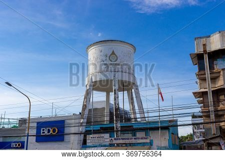 Puerto Princesa, Palawan, Philippines - September 26, 2018: Cityscape With Large Water Tower In The
