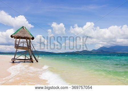 Perfect Landscape Of Tropical Island With Bright Azure Water And Awe Clouds On Blue Sky. Empty Lifeg