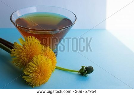 Yellow Dandelions And Dandelion Jam On A Blue Background.dandelion Honey