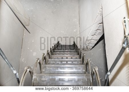 Sliding Metal Stairs To The Attic In The Ceiling, Open Flap And Unfolded Stairs, Modern Look. View F