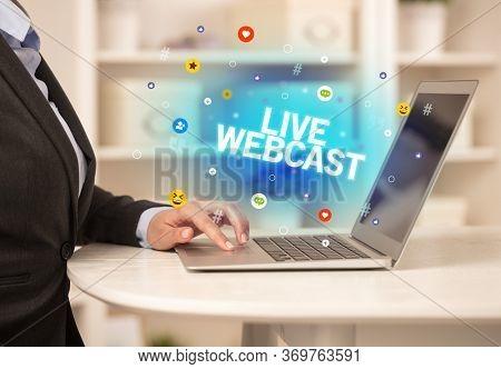 Freelance woman using laptop with LIVE WEBCAST inscription, Social media concept