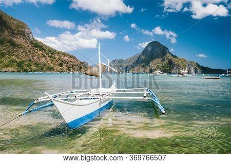 White Boat In El Nido Bay And Cadlao Island, Palawan, Philippines