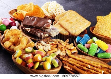 Salty Snacks. Pretzels, Chips, Crackers In Wooden Bowls On Table