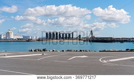 Industrial Wharf Of An Australian City's Harbor With Infrastructure For Exporting Mining And Agricul