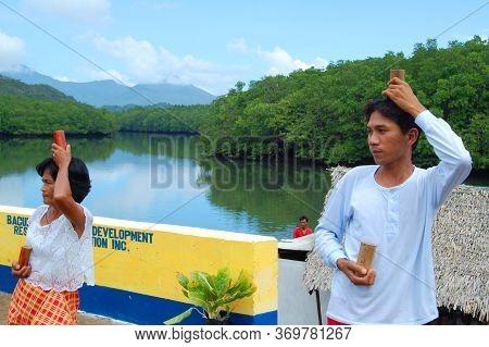 Palawan, Ph - Nov 28 - Bacungan Mangrove River Glass Dance Performers On November 28, 2009 In Puerto