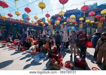 Kowloon, Hong Kong, China - January 13, 2016: People Praying At Sik Sik Yuen Wong Tai Sin Temple,won