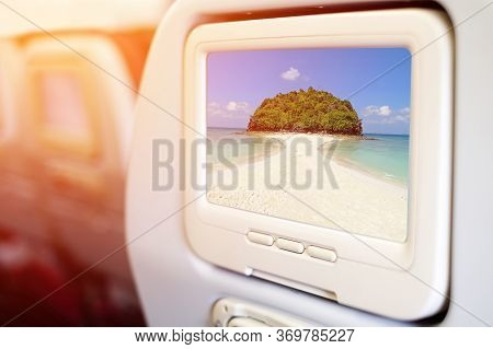 Aircraft Monitor In Front Of Passenger Seat Showing Miracle Beach & Crystal Clear Water At Koh Kai,