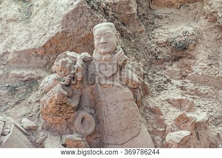 Xian, China - May 1, 2010: Terracotta Army Excavation Site. Beige Sculpture Of Human Partly Broken I