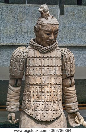 Xian, China - May 1, 2010: Terracotta Army Museum. Upper Body Of Beige-brown Sculpted Giant Soldier