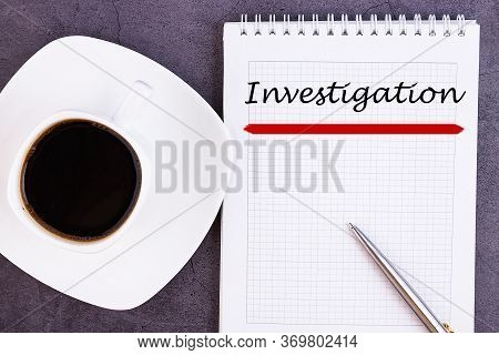 The Text, The Inscription, The Phrase Investigation Is Written In A Notebook That Lies On A Dark Tab