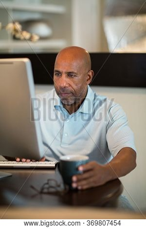 Mature African American Man Working From His Home Office.