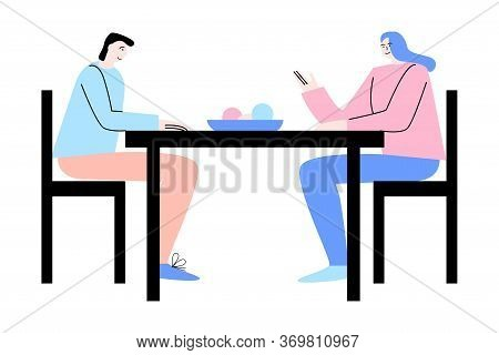 Young Couple Sitting, Talking And Having Dinner After Working Day On Weekday